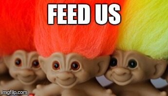 Treasure trolls | FEED US | image tagged in treasure trolls | made w/ Imgflip meme maker