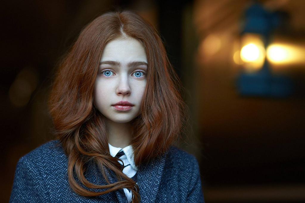 Young girl with red hair apologise
