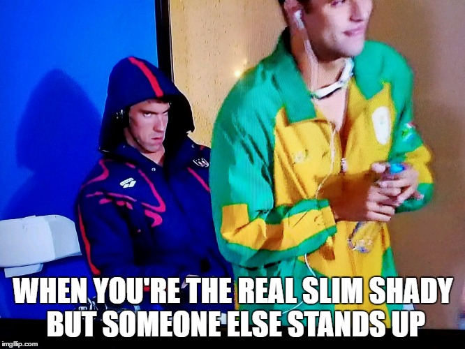 Phelps face meme |  WHEN YOU'RE THE REAL SLIM SHADY BUT SOMEONE ELSE STANDS UP | image tagged in angry phelps | made w/ Imgflip meme maker
