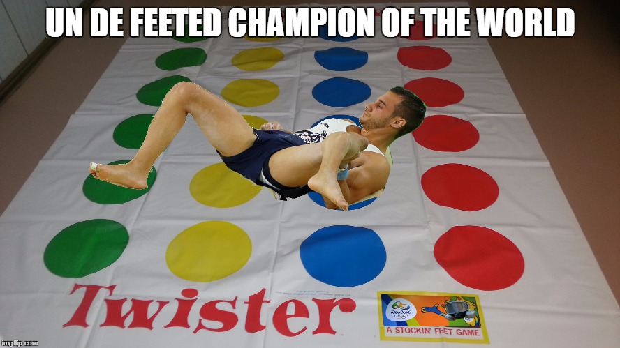 a true hero  |  UN DE FEETED CHAMPION OF THE WORLD | image tagged in memes,2016 olympics,broken leg,rio,first world problems | made w/ Imgflip meme maker