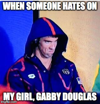 Michael Phelps Death Stare Meme |  WHEN SOMEONE HATES ON; MY GIRL, GABBY DOUGLAS | image tagged in michael phelps death stare | made w/ Imgflip meme maker