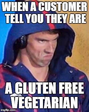 Angry Phelps |  WHEN A CUSTOMER TELL YOU THEY ARE; A GLUTEN FREE VEGETARIAN | image tagged in angry phelps | made w/ Imgflip meme maker