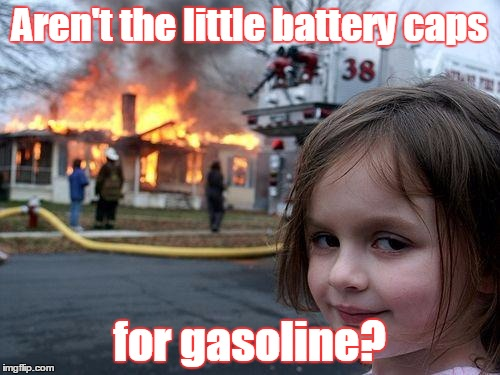 Disaster Girl Meme | Aren't the little battery caps for gasoline? | image tagged in memes,disaster girl | made w/ Imgflip meme maker