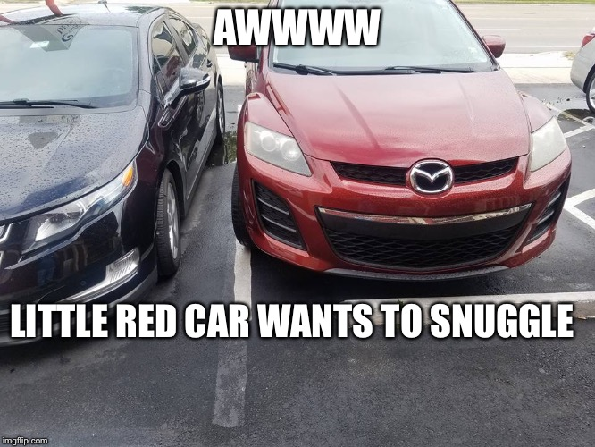 Sometimes it's not terrible parking skills | AWWWW LITTLE RED CAR WANTS TO SNUGGLE | image tagged in cars,parking,snuggle,memes | made w/ Imgflip meme maker