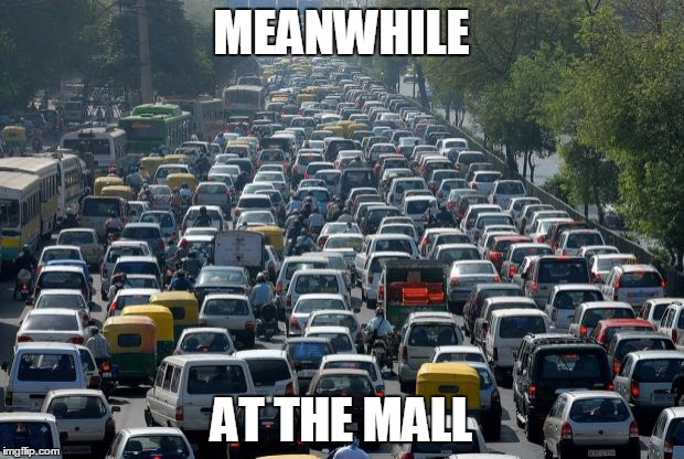Christmas traffic... for the love of God someone kill me. | MEANWHILE AT THE MALL | image tagged in traffic | made w/ Imgflip meme maker