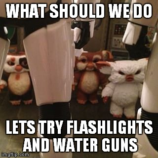 Rogue Gremlin One | WHAT SHOULD WE DO LETS TRY FLASHLIGHTS AND WATER GUNS | image tagged in star wars,gremlins,stormtroopers,uh oh | made w/ Imgflip meme maker