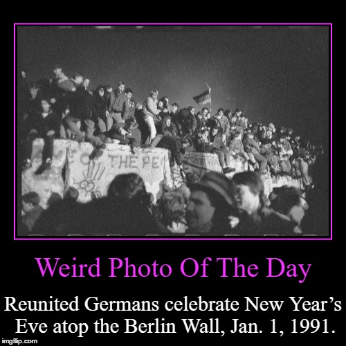 Two Months After The Border Between The Divided City Was Opened. | Weird Photo Of The Day | Reunited Germans celebrate New Year's Eve atop the Berlin Wall, Jan. 1, 1991. | image tagged in funny,demotivationals,weird,photo of the day,new year's eve,berlin wall | made w/ Imgflip demotivational maker