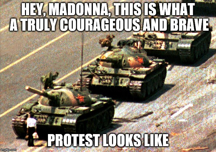 HEY, MADONNA, THIS IS WHAT A TRULY COURAGEOUS AND BRAVE PROTEST LOOKS LIKE | image tagged in madonna,ashley judd,feminazis,libtards | made w/ Imgflip meme maker
