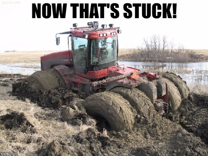 Stuck in the mud tractor | NOW THAT'S STUCK! | image tagged in memes,funny,tractor,stuck,mud,farm | made w/ Imgflip meme maker