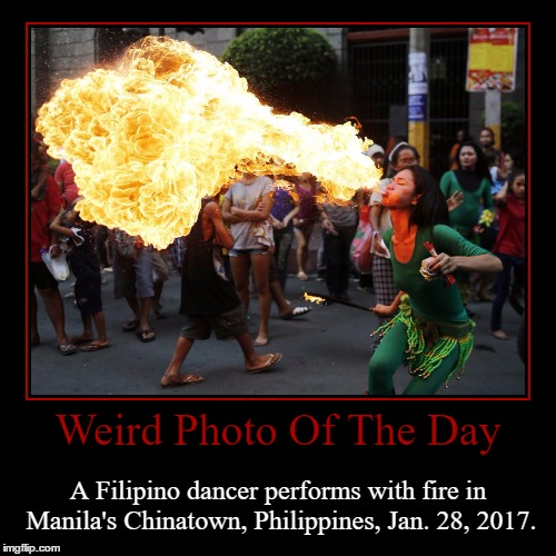 Happy Luna New Year! | Weird Photo Of The Day | A Filipino dancer performs with fire in Manila's Chinatown, Philippines, Jan. 28, 2017. | image tagged in funny,demotivationals,weird,photo of the day,chinese new year,philippines | made w/ Imgflip demotivational maker