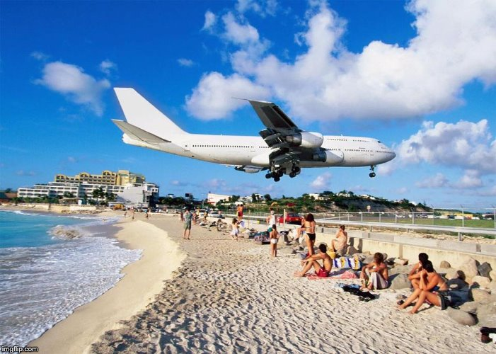 The breezy beach | image tagged in maho beach st martin,vacation,beach,airplanes,island | made w/ Imgflip meme maker