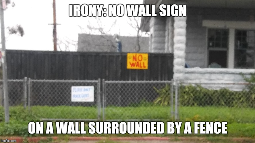 fenced in |  IRONY: NO WALL SIGN; ON A WALL SURROUNDED BY A FENCE | image tagged in trump wall | made w/ Imgflip meme maker