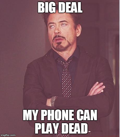 Face You Make Robert Downey Jr Meme | BIG DEAL MY PHONE CAN PLAY DEAD | image tagged in memes,face you make robert downey jr | made w/ Imgflip meme maker