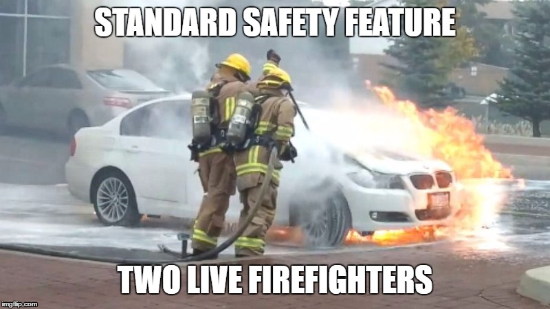 Live in the emergency lane. | STANDARD SAFETY FEATURE TWO LIVE FIREFIGHTERS | image tagged in bmw,on fire | made w/ Imgflip meme maker