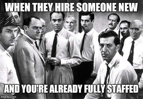 That feeling of foreboding | WHEN THEY HIRE SOMEONE NEW AND YOU'RE ALREADY FULLY STAFFED | image tagged in serious group,retail,job,work,office | made w/ Imgflip meme maker