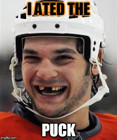 I ATED THE PUCK | image tagged in hockey teeth | made w/ Imgflip meme maker