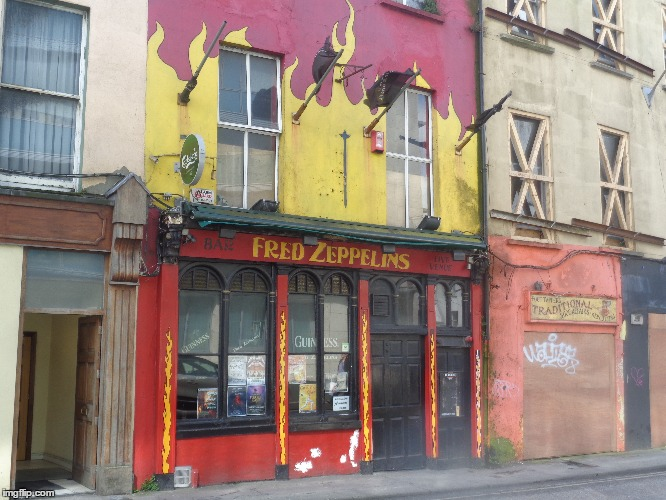 Guess you could say this building is pretty LIT... | image tagged in cork artist,ireland,led zeppelin,flames,humor | made w/ Imgflip meme maker