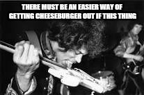 THERE MUST BE AN EASIER WAY OF GETTING CHEESEBURGER OUT IF THIS THING | made w/ Imgflip meme maker