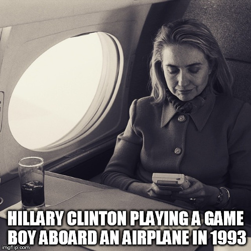 Game Boy week! July 1st to July 7th. | HILLARY CLINTON PLAYING A GAME BOY ABOARD AN AIRPLANE IN 1993 | image tagged in gameboy,gameboy week,hilary clinton | made w/ Imgflip meme maker