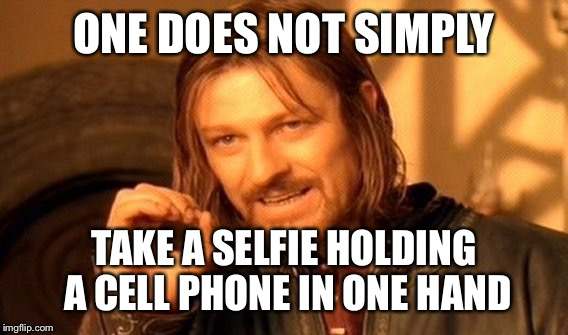 One Does Not Simply Meme | ONE DOES NOT SIMPLY TAKE A SELFIE HOLDING A CELL PHONE IN ONE HAND | image tagged in memes,one does not simply | made w/ Imgflip meme maker