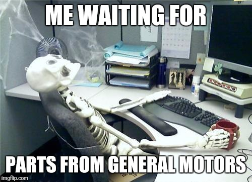ME WAITING FOR PARTS FROM GENERAL MOTORS | image tagged in skeleton desk | made w/ Imgflip meme maker