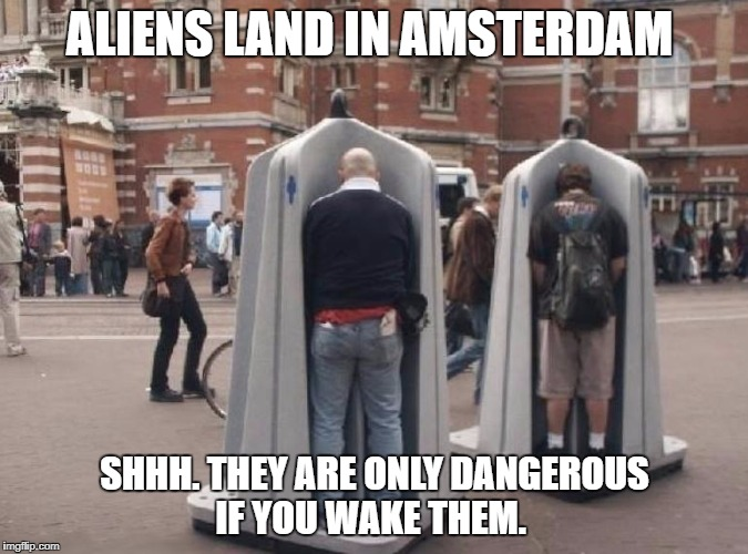 Alien Zombies Land in Europe | ALIENS LAND IN AMSTERDAM SHHH. THEY ARE ONLY DANGEROUS IF YOU WAKE THEM. | image tagged in zombies,peeing,beer,football,horror | made w/ Imgflip meme maker
