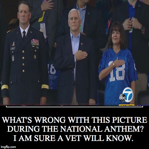 WHAT'S WRONG WITH THIS PICTURE DURING THE NATIONAL ANTHEM? I AM SURE A VET WILL KNOW. | image tagged in funny,national anthem,disrespect,no salute | made w/ Imgflip demotivational maker
