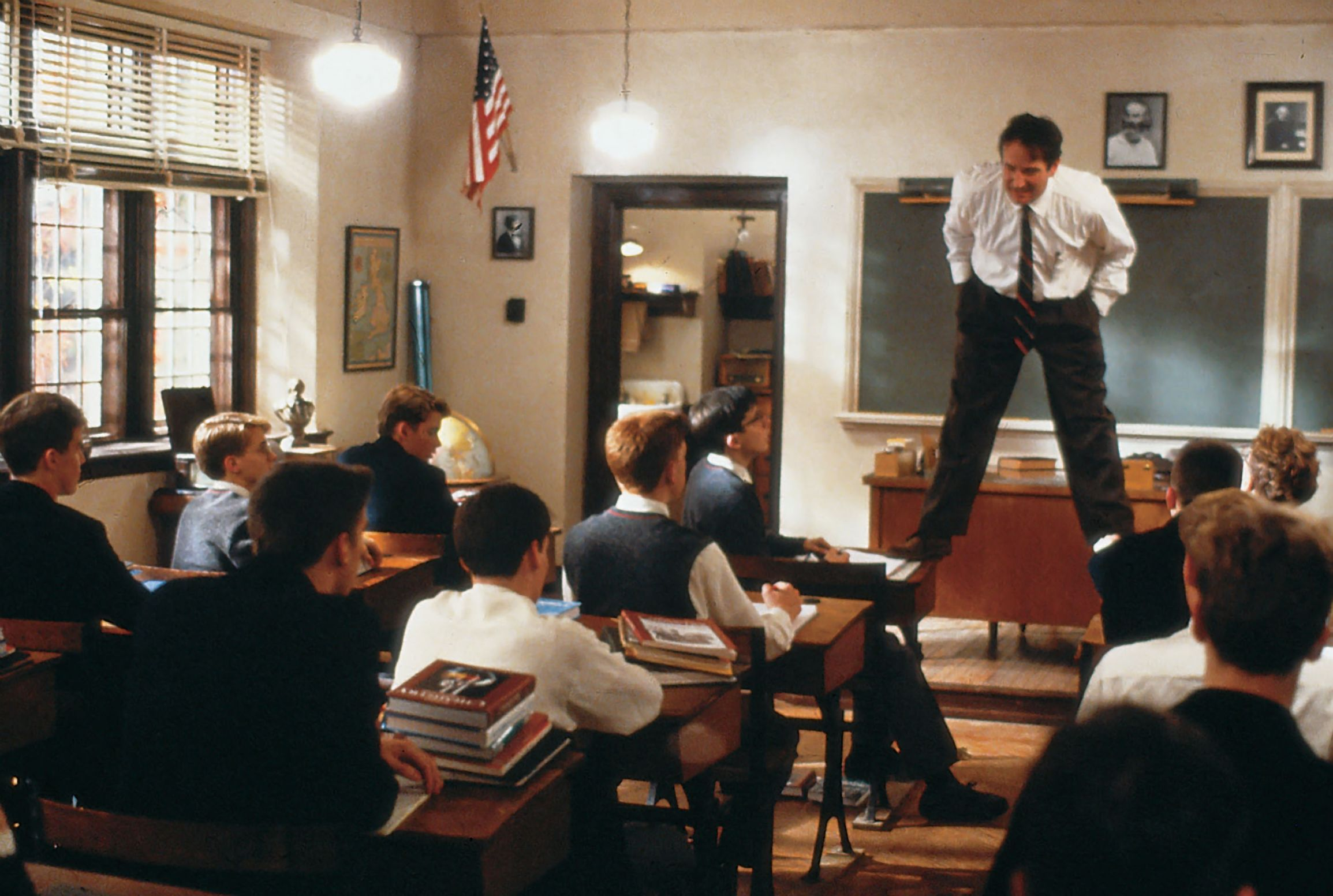 Dead Poets Society Teacher Robin Williams Standing On Desk In Cl