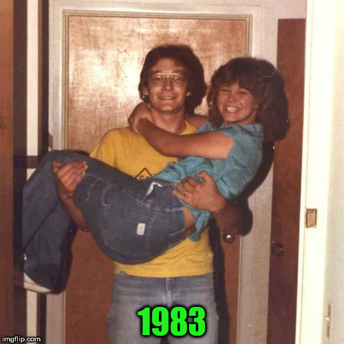 Too busy to make a 3rd submission. So here's hokeewolf carrying his new bride over the threshold of our apartment | 1983 | image tagged in hokeewolf,throwback | made w/ Imgflip meme maker