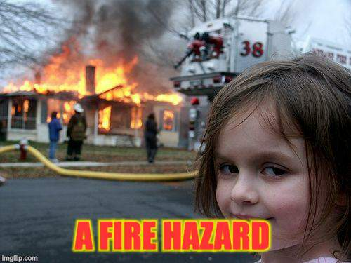 Disaster Girl Meme | A FIRE HAZARD | image tagged in memes,disaster girl | made w/ Imgflip meme maker