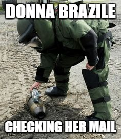 The perils of crossing the DNC | DONNA BRAZILE CHECKING HER MAIL | image tagged in donna brazile,hillary clinton,dnc | made w/ Imgflip meme maker