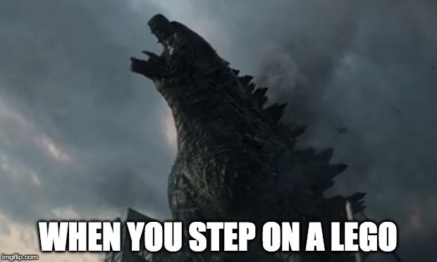 The pain...the horror... | WHEN YOU STEP ON A LEGO | image tagged in lego,godzilla | made w/ Imgflip meme maker