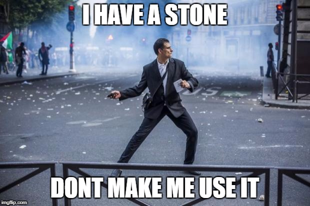 I HAVE A STONE DONT MAKE ME USE IT | image tagged in french protester | made w/ Imgflip meme maker