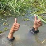 Drowning Thumbs Up meme