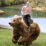 Whoa-oh Putin on a bear | WHOA-OH, WE'RE HALFWAY THERE. WHOA-OH... | image tagged in putin,bear,bonjovi | made w/ Imgflip meme maker