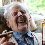 old man drinking and smoking