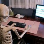 skeleton at computer desk meme