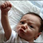 Baby Raising Fist meme