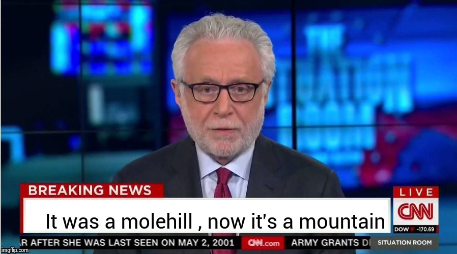 It was a molehill , now it's a mountain | image tagged in corporate stooge | made w/ Imgflip meme maker