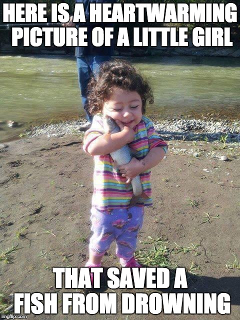 A killer...but yet innocent. | HERE IS A HEARTWARMING PICTURE OF A LITTLE GIRL THAT SAVED A FISH FROM DROWNING | image tagged in child hug fish | made w/ Imgflip meme maker