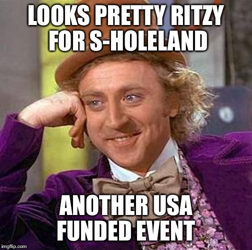 Creepy Condescending Wonka Meme | LOOKS PRETTY RITZY FOR S-HOLELAND ANOTHER USA FUNDED EVENT | image tagged in memes,creepy condescending wonka | made w/ Imgflip meme maker
