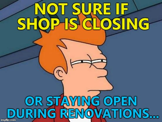 "One sign in the window says ""bear with us"", the other ""see you soon""... 