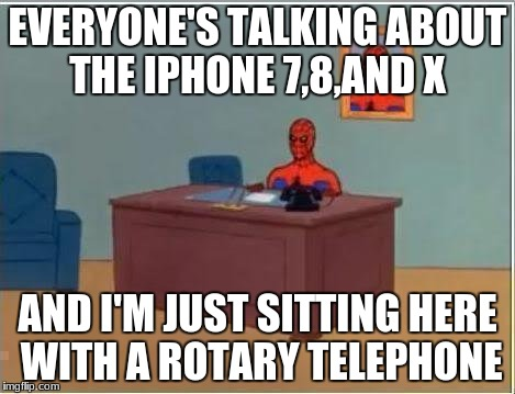 Spiderman Computer Desk Meme | EVERYONE'S TALKING ABOUT THE IPHONE 7,8,AND X AND I'M JUST SITTING HERE WITH A ROTARY TELEPHONE | image tagged in memes,spiderman computer desk,spiderman | made w/ Imgflip meme maker