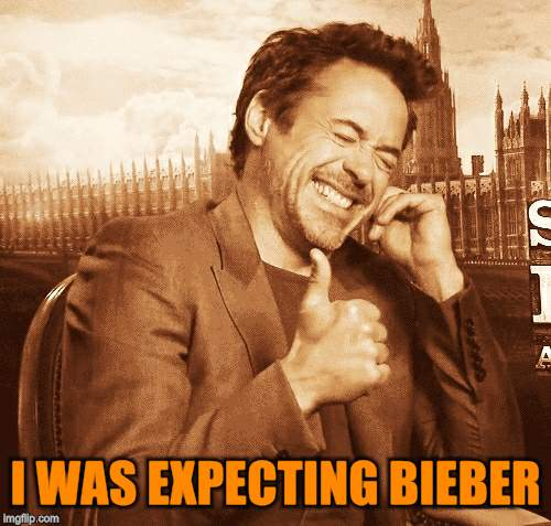laughing | I WAS EXPECTING BIEBER | image tagged in laughing | made w/ Imgflip meme maker
