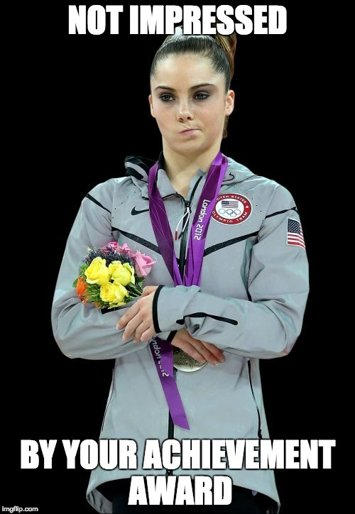 McKayla Maroney Not Impressed 2 Meme |  NOT IMPRESSED; BY YOUR ACHIEVEMENT AWARD | image tagged in memes,mckayla maroney not impressed2 | made w/ Imgflip meme maker