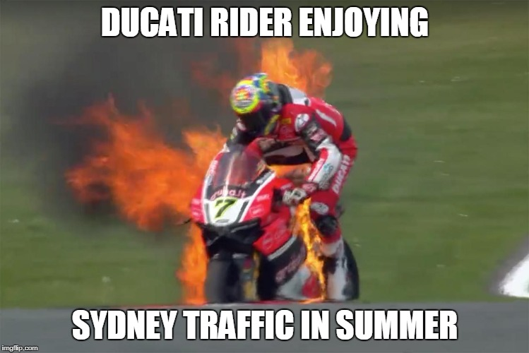 DUCATI RIDER ENJOYING SYDNEY TRAFFIC IN SUMMER | image tagged in ducati sydney ducati rider hot bike | made w/ Imgflip meme maker