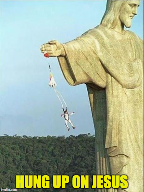 A Golden Parachute | HUNG UP ON JESUS | image tagged in jesus,statue | made w/ Imgflip meme maker