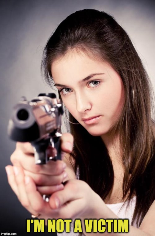 Girl with gun |  I'M NOT A VICTIM | image tagged in girl with gun | made w/ Imgflip meme maker