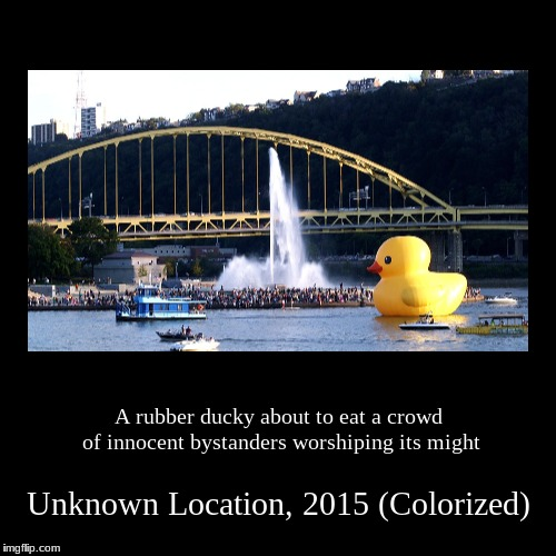 That duck seems hungry | A rubber ducky about to eat a crowd of innocent bystanders worshiping its might | Unknown Location, 2015 (Colorized) | image tagged in demotivationals | made w/ Imgflip demotivational maker