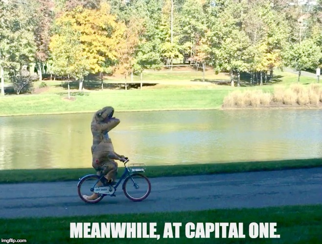 Meanwhile at Capital One | image tagged in meanwhile,capital one,dinosaur,campus,bike | made w/ Imgflip meme maker